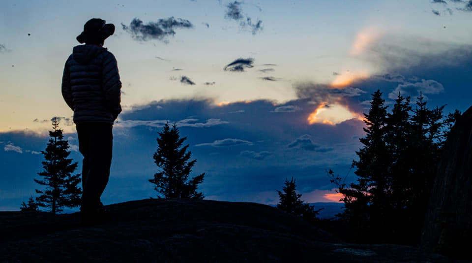 Mark watching the sunset from summit of St Regis Mountain